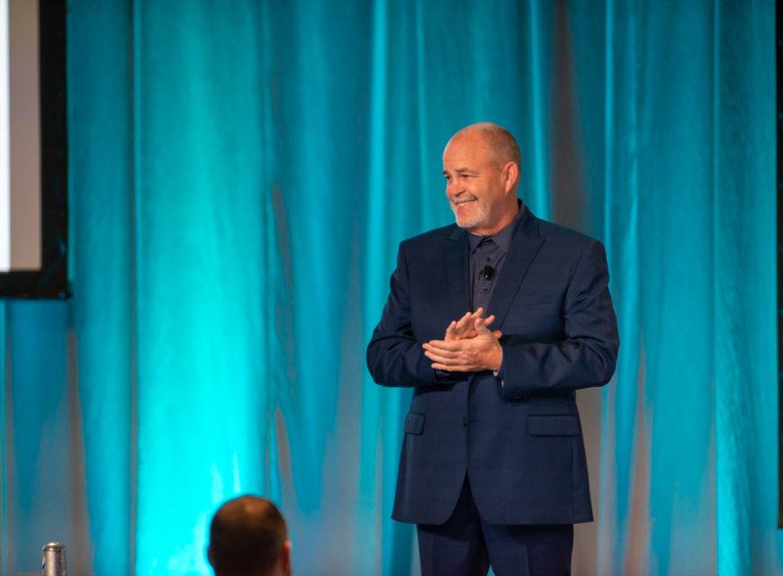 CU*Answers CEO Randy Karnes leads the festivities.