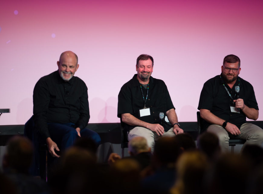 """Karnes sits on stage with CU*Answers EVP of Software Development Brian Maurer and VP of MTG Product Design & Business Development Ken Vaughn to talk about the future of the """"It's Me 247"""" suite."""