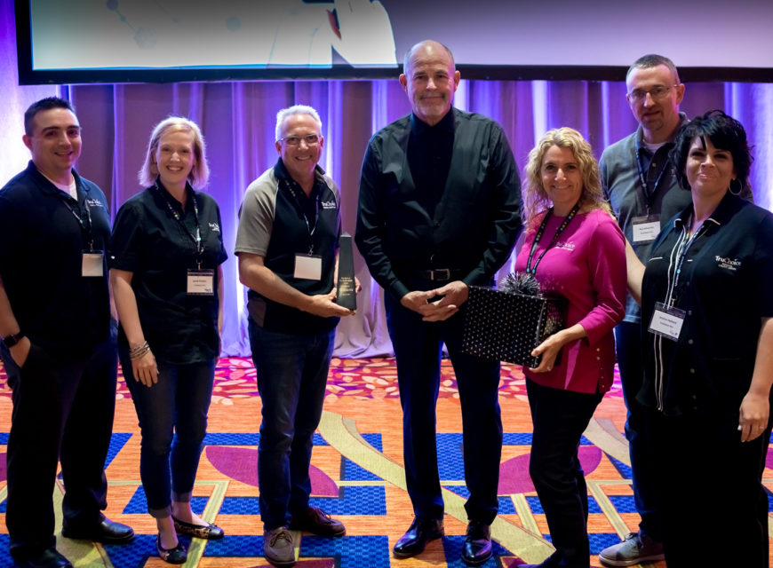 Randy stands with members of TruChoice Federal Credit Union, winner of the 2019 Spirit of CU*Answers Award.