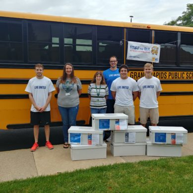 Community Pulls Together to Stuff the Bus – and Sets a Record