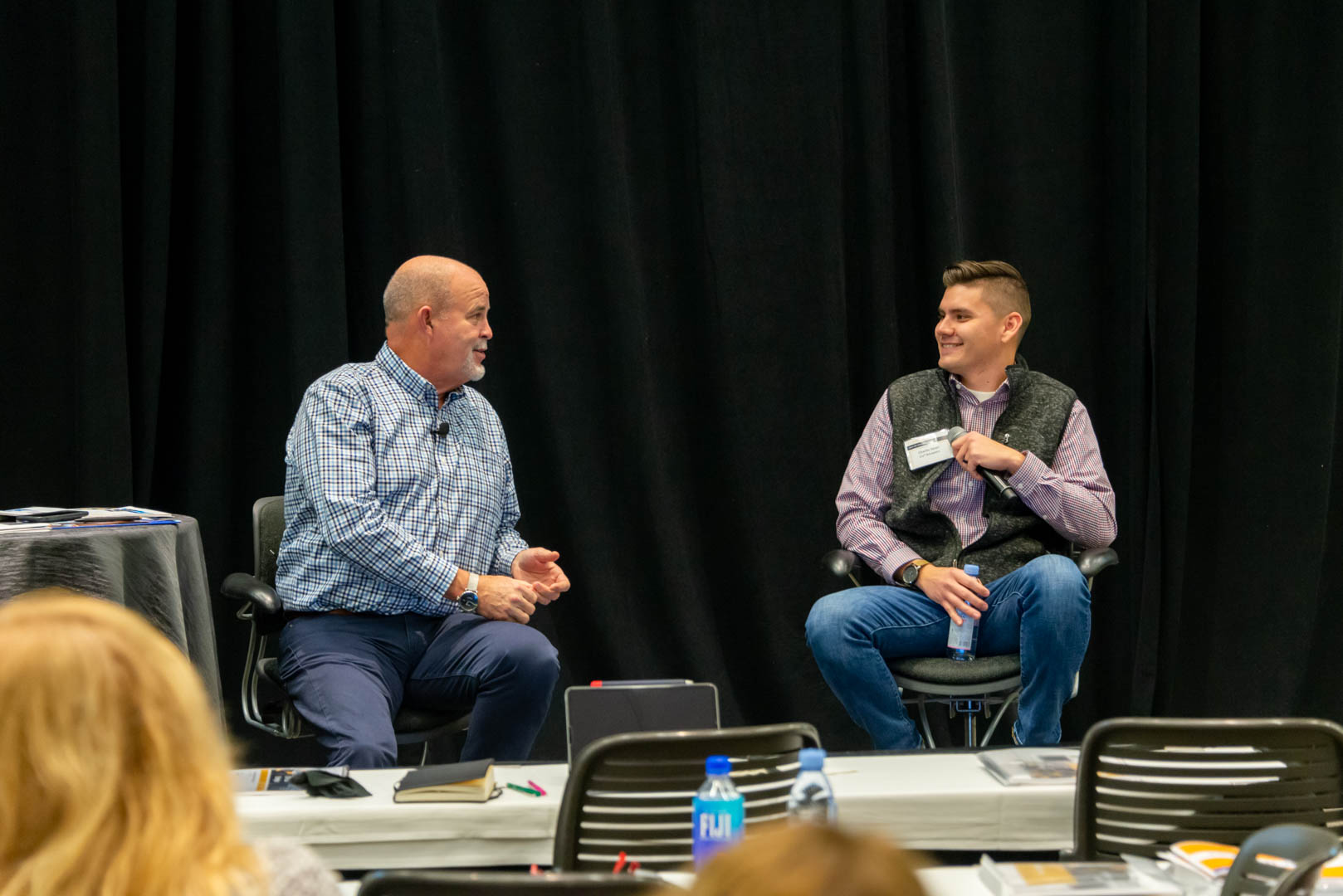 CU*Answers CEO Randy Karnes (left) is joined on stage by Charlie Dean of Lender*VP.