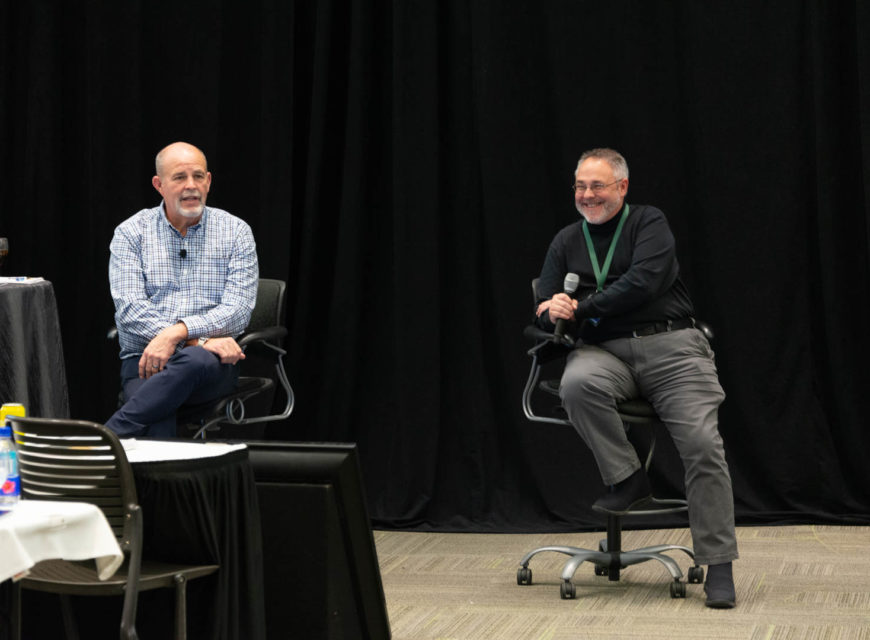CU*Answers CEO Randy Karnes (left) is joined on stage by CU*Answers OpsEngine Business Development Manager Jeff Miller.