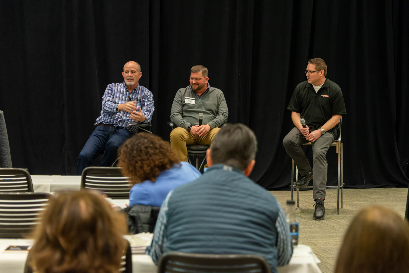CU*Answers CEO Randy Karnes (left) is joined on stage by CU*Answers VP of Mobile Technologies Group Ken Vaughn (center) and VP of Marketing Services & Creative Director David Damstra.